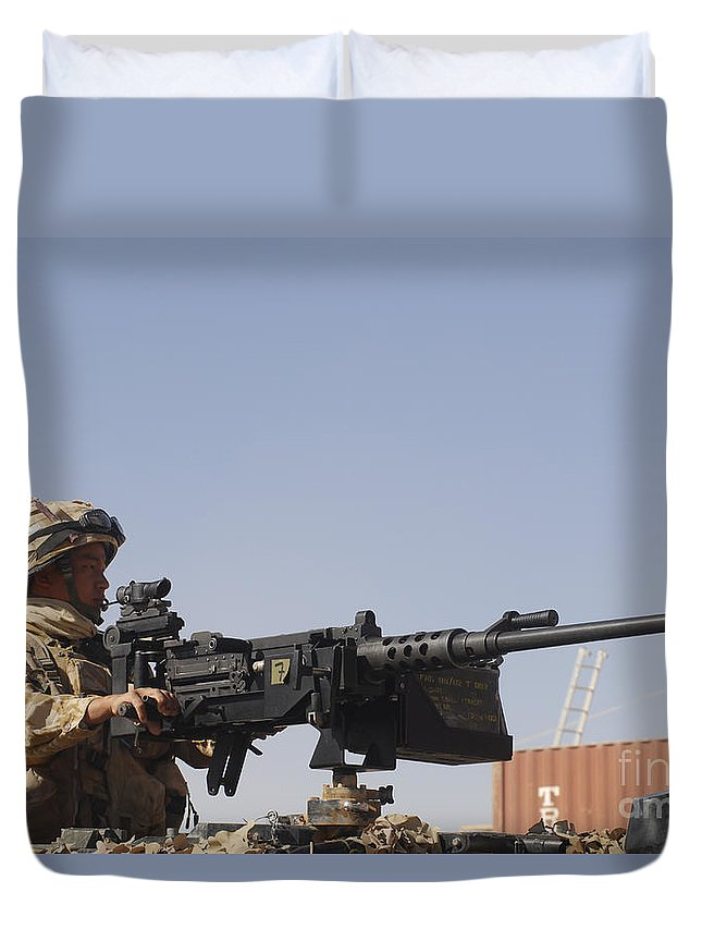 Middle East Duvet Cover featuring the photograph A Royal Marine Manning A .50 Caliber by Andrew Chittock