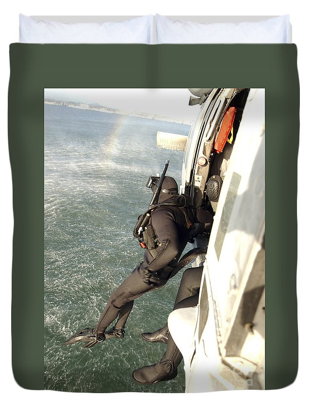 San Diego Duvet Cover featuring the photograph A Search And Rescue Swimmer Student by Stocktrek Images