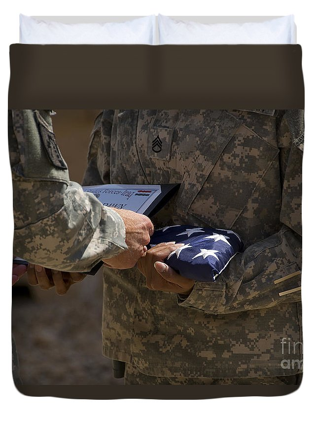 Airmen Duvet Cover featuring the photograph A Soldier Is Presented The American by Stocktrek Images