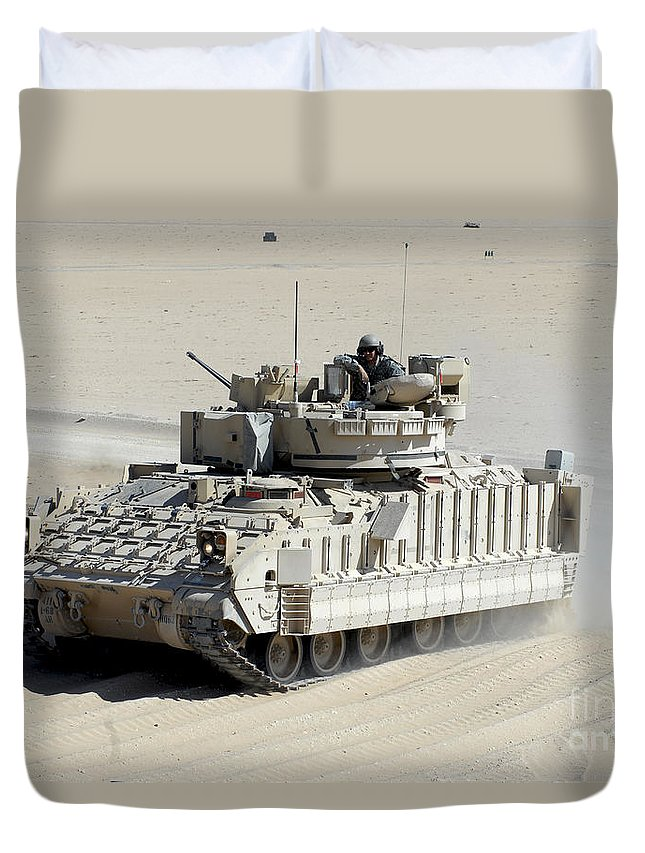 Gunner Duvet Cover featuring the photograph A Soldier Looks Out Of The Top Hatch by Stocktrek Images