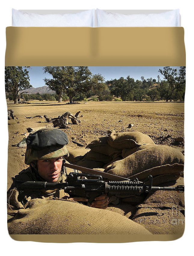 Naval Mobile Construction Battalion Duvet Cover featuring the photograph A Soldier Mans His Position At Fort by Stocktrek Images