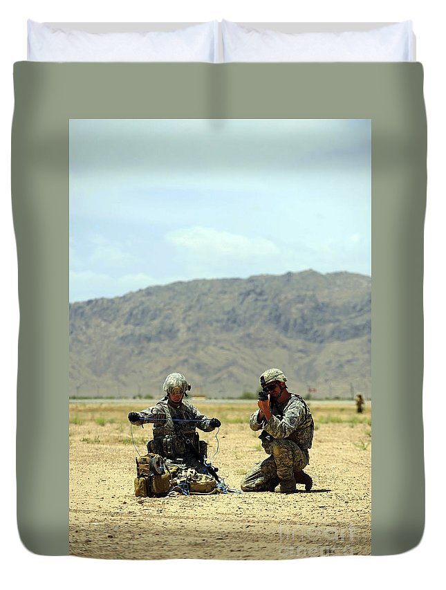 Operation Enduring Freedom Duvet Cover featuring the photograph A Soldier Prepares A Drag Line While An by Stocktrek Images