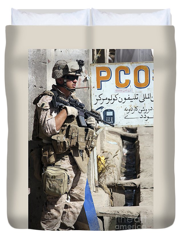 Sangin Duvet Cover featuring the photograph A Soldier Provides Security by Stocktrek Images