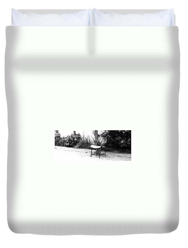 Monochromatic Duvet Cover featuring the photograph A Torn Chair by Sumit Mehndiratta