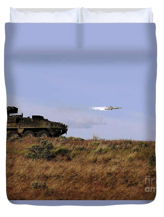Yakima Training Center Duvet Cover featuring the photograph A Tow Missile Is Launched From An by Stocktrek Images