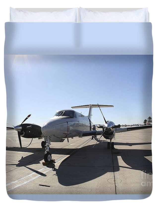 Uc-12f King Air Duvet Cover featuring the photograph A Uc-12f King Air Aircraft by Stocktrek Images