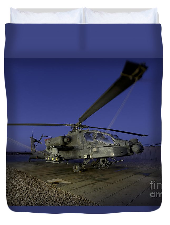 Army Duvet Cover featuring the photograph A U.s. Army Ah-64d Apache Helicopter by Stocktrek Images