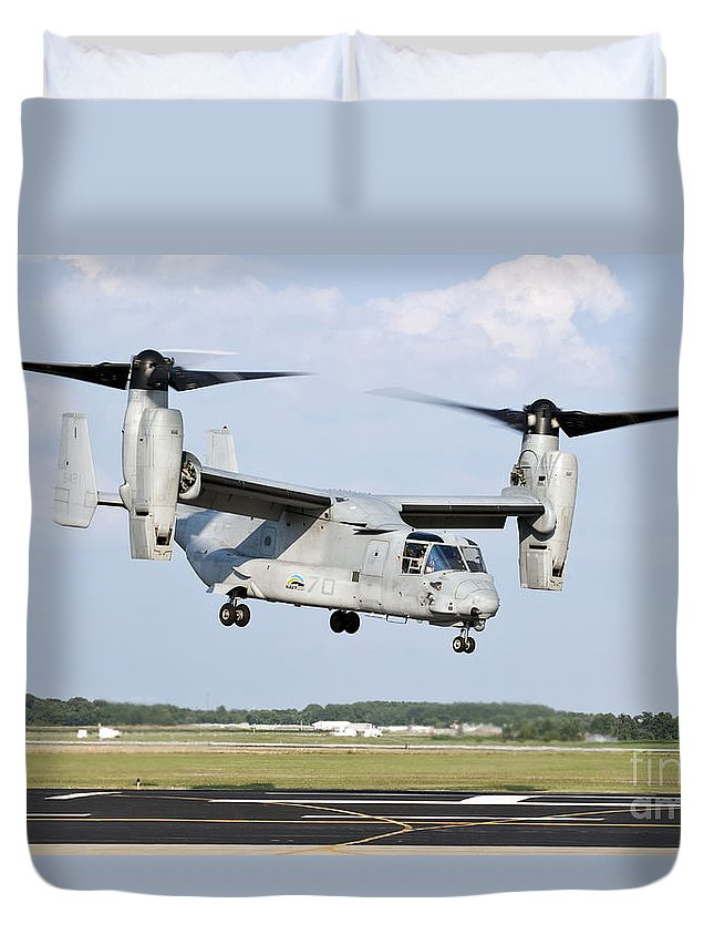 Environment Duvet Cover featuring the photograph A U.s. Marine Corps Mv-22 Osprey Lifts by Stocktrek Images