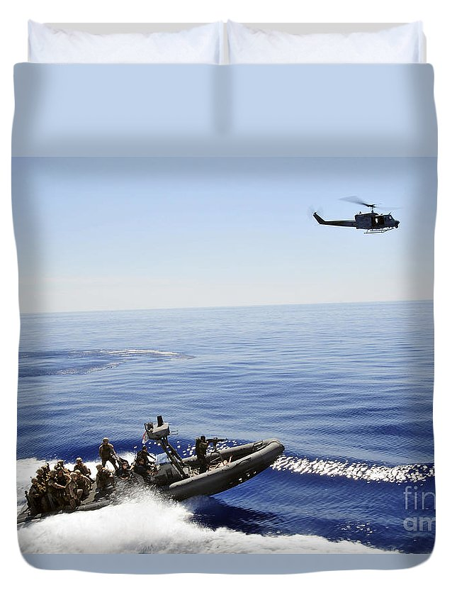 Chasing Duvet Cover featuring the photograph A U.s. Navy Uh-1n Huey Helicopter by Stocktrek Images
