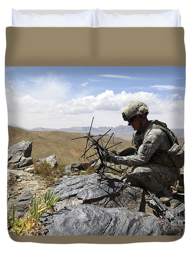 Afghanistan Duvet Cover featuring the photograph A U.s. Soldier Sets Up A Portable by Stocktrek Images