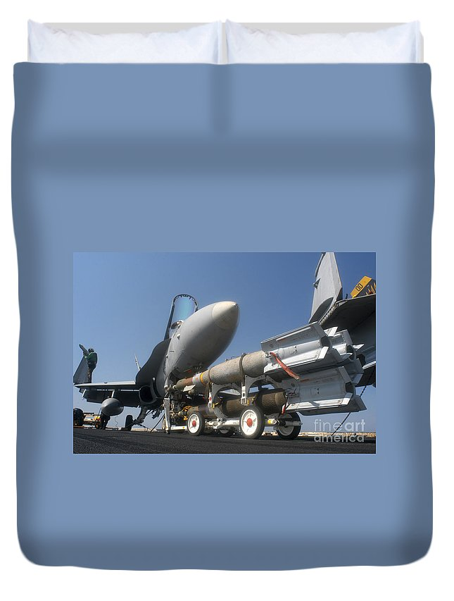 Horizontal Duvet Cover featuring the photograph A Weapons Skid Carrying 500-pound by Stocktrek Images