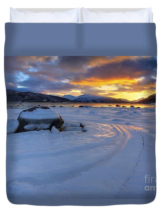 Evenskjer Duvet Cover featuring the photograph A Winter Sunset Over Tjeldsundet by Arild Heitmann