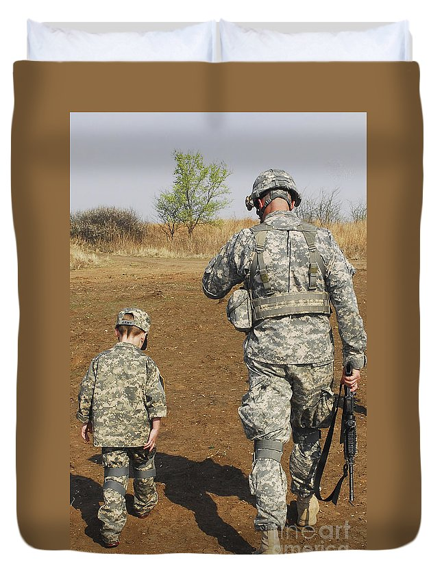 Boys Duvet Cover featuring the photograph A Young Boy Joins His Squad Leader by Stocktrek Images