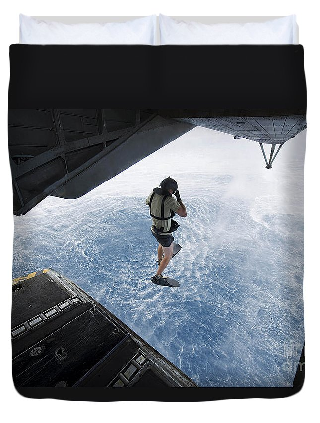 Ch-53e Super Stallion Duvet Cover featuring the photograph Air Force Pararescueman Jumps by Stocktrek Images