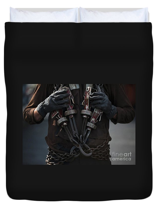 Close-up Duvet Cover featuring the photograph Airman Carries Aircraft Tie-down Chains by Stocktrek Images
