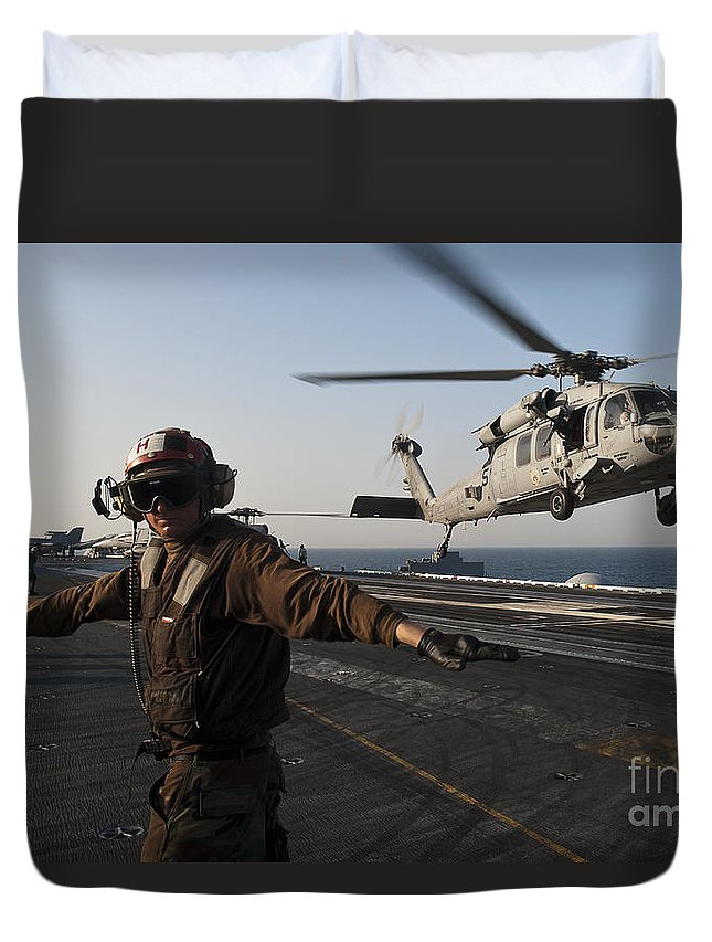 Operation New Dawn Duvet Cover featuring the photograph Airman Checks For A Clear Deck As An by Stocktrek Images