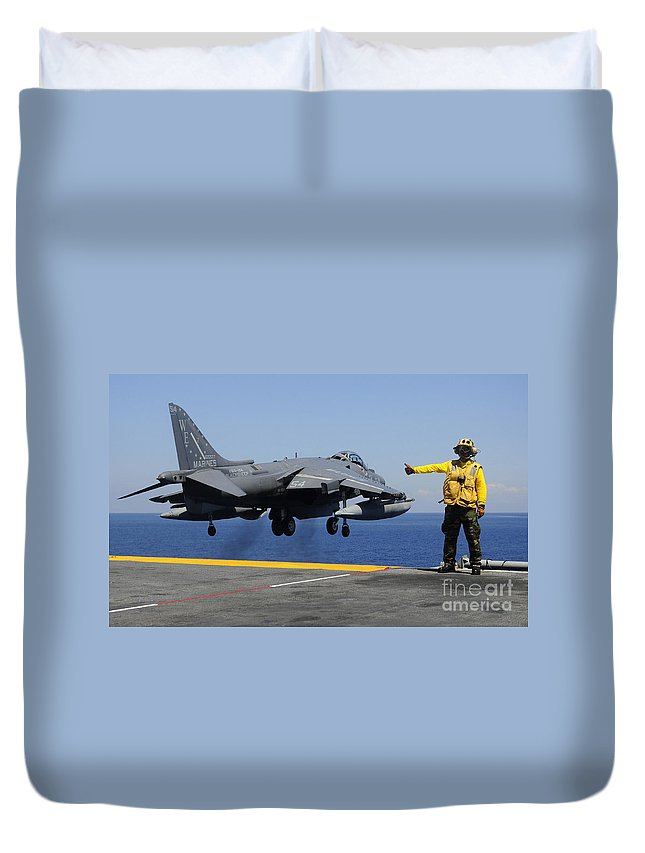 Uss Essex Duvet Cover featuring the photograph Airman Gives The Thumbs-up Signal As An by Stocktrek Images