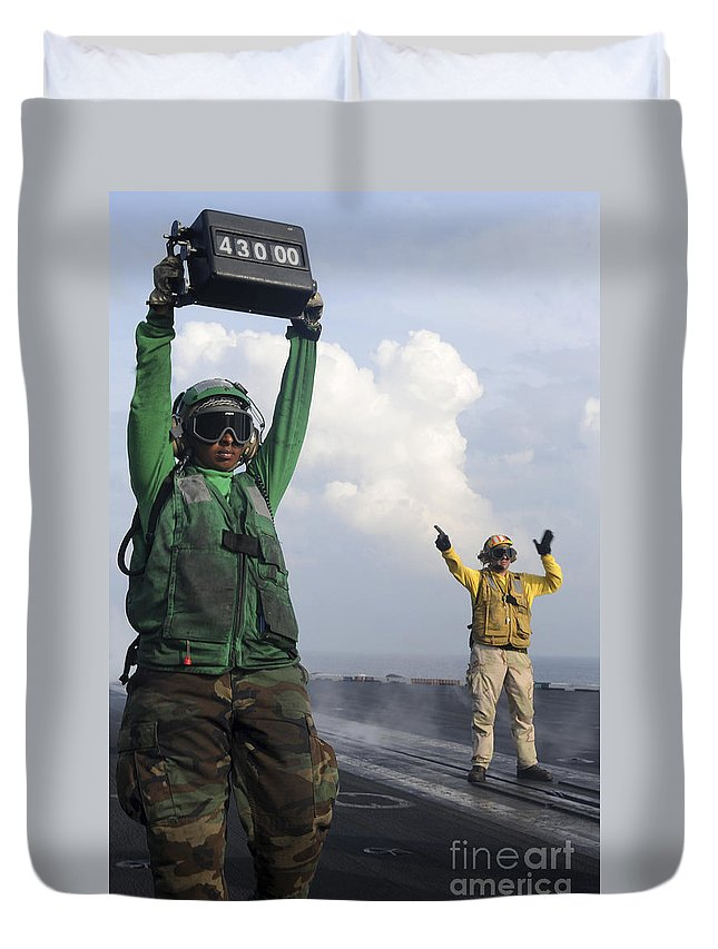 Uss John C Stennis Duvet Cover featuring the photograph Airmen Communicate To Aircraft Aboard by Stocktrek Images