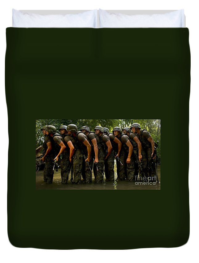 Toughness Duvet Cover featuring the photograph Airmen Stack Up In A Pond by Stocktrek Images
