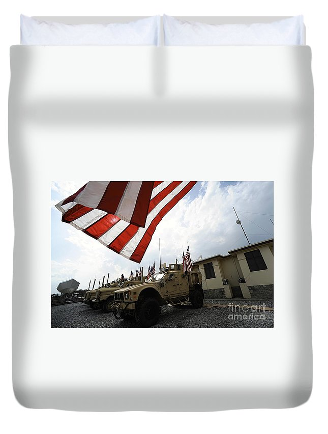 Symbolic Duvet Cover featuring the photograph American Flags Are Displayed by Stocktrek Images