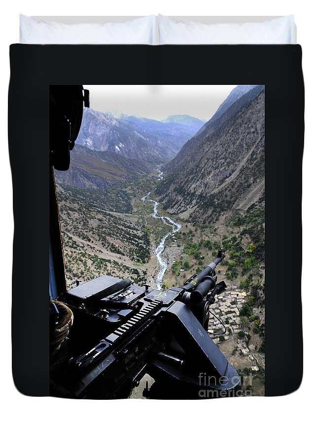 Afghanistan Duvet Cover featuring the photograph An Aerial Gunner Surveys by Stocktrek Images