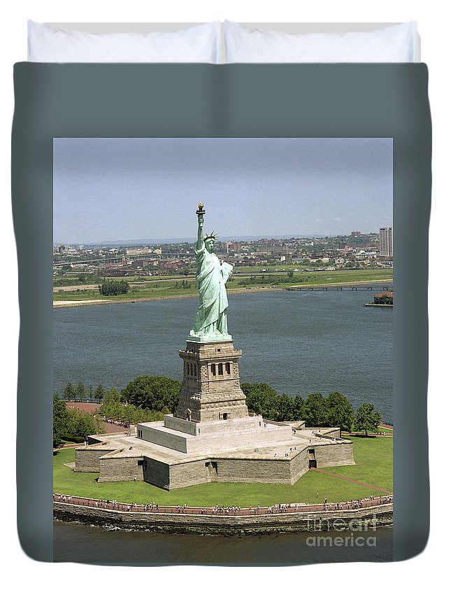 Symbolic Duvet Cover featuring the photograph An Aerial View Of The Statue Of Liberty by Stocktrek Images