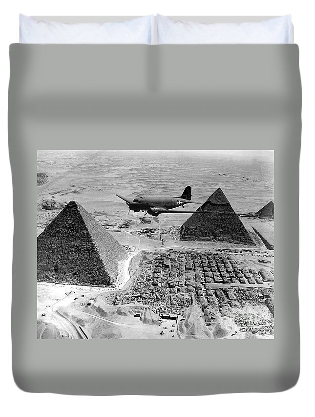 Army Duvet Cover featuring the photograph An Air Transport Command Plane Flies by Stocktrek Images