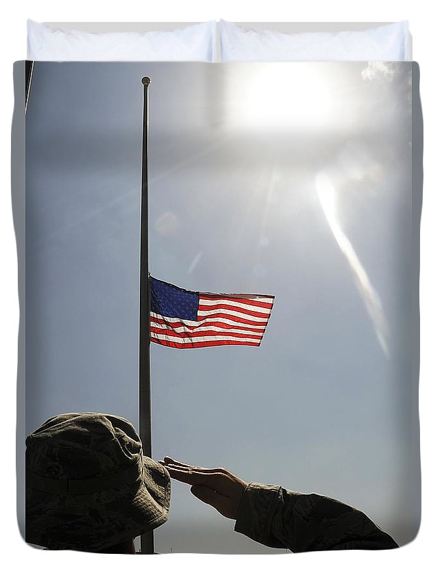 Adults Only Duvet Cover featuring the photograph An Airman Salutes The American Flag by Stocktrek Images
