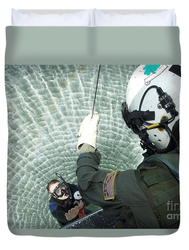 Sailor Duvet Cover featuring the photograph An Aviation Rescue Swimmer Instructor by Stocktrek Images