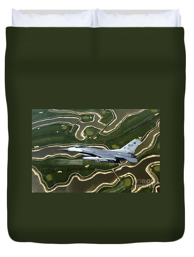 Color Image Duvet Cover featuring the photograph An F-16 Fighting Falcon Flies Near Base by Stocktrek Images