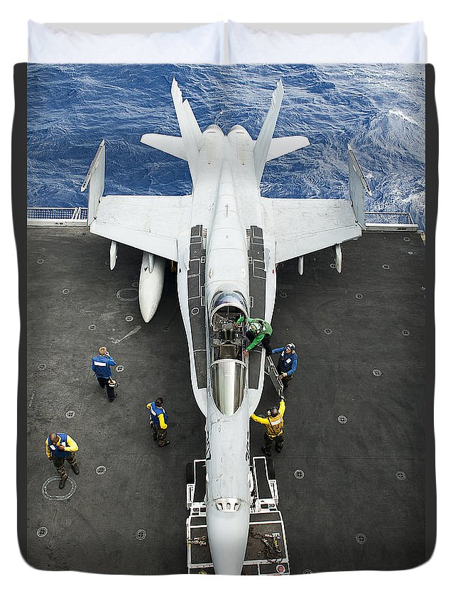At The Edge Of Duvet Cover featuring the photograph An Fa-18c Hornet Aircraft by Stocktrek Images