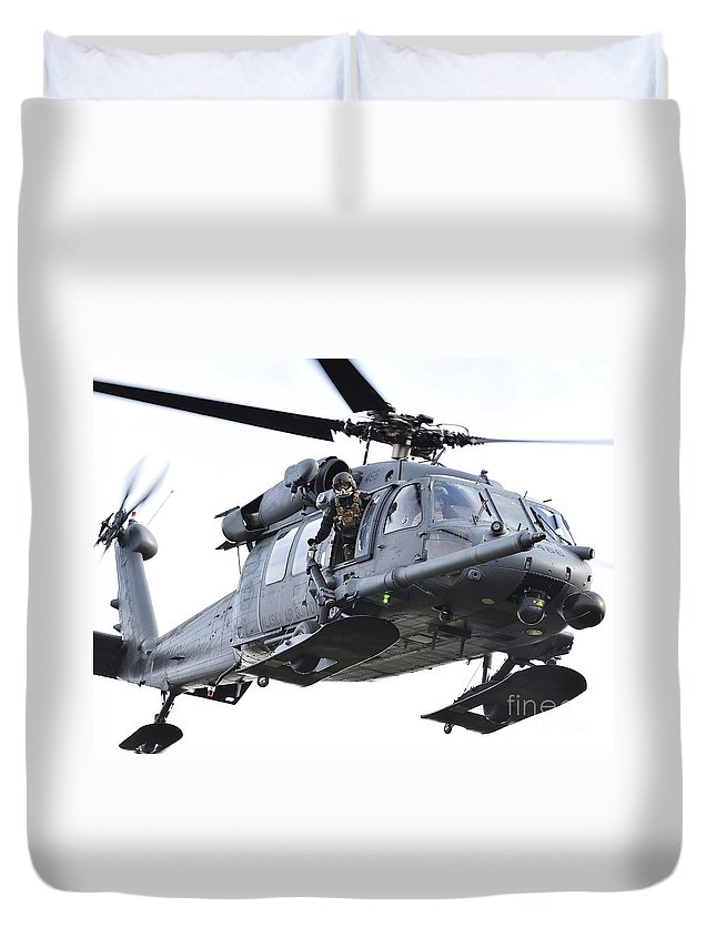 Window Duvet Cover featuring the photograph An Hh-60g Pavehawk Helicopter In Flight by Stocktrek Images
