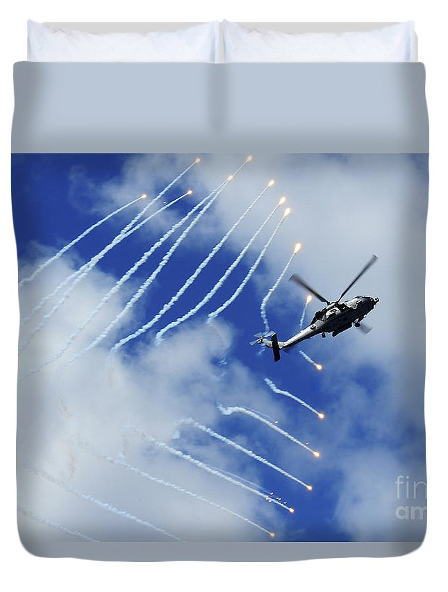 Airshow Duvet Cover featuring the photograph An Hh-60h Sea Hawk Helicopter Releases by Stocktrek Images