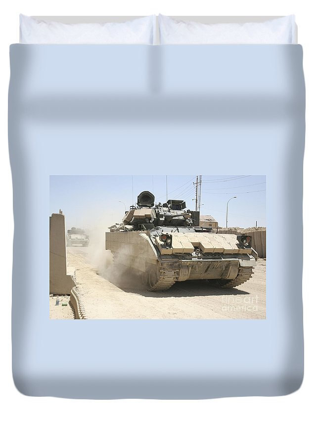 Army Duvet Cover featuring the photograph An M2 Bradley Fighting Vehicle Patrols by Stocktrek Images