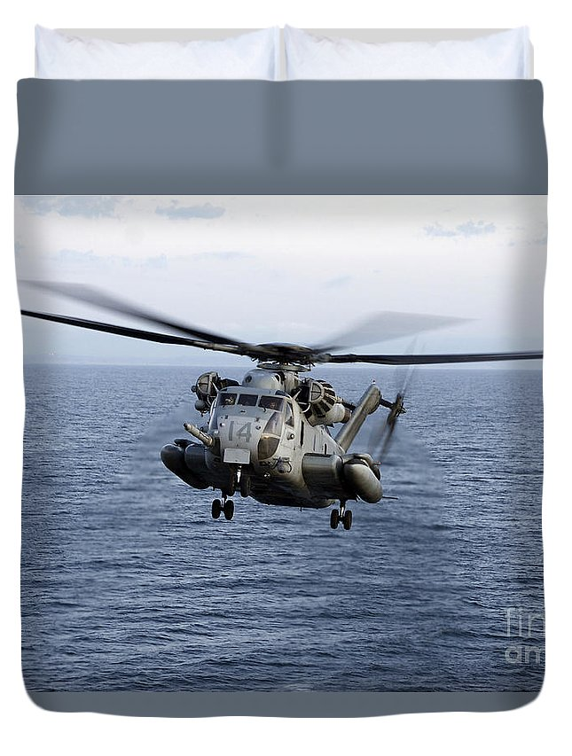 Transportation Duvet Cover featuring the photograph An Mh-53e Sea Dragon In Flight by Stocktrek Images