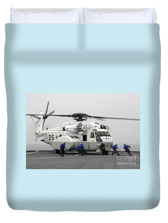 Motion Duvet Cover featuring the photograph An Mh-53e Super Stallion Helicopter by Stocktrek Images