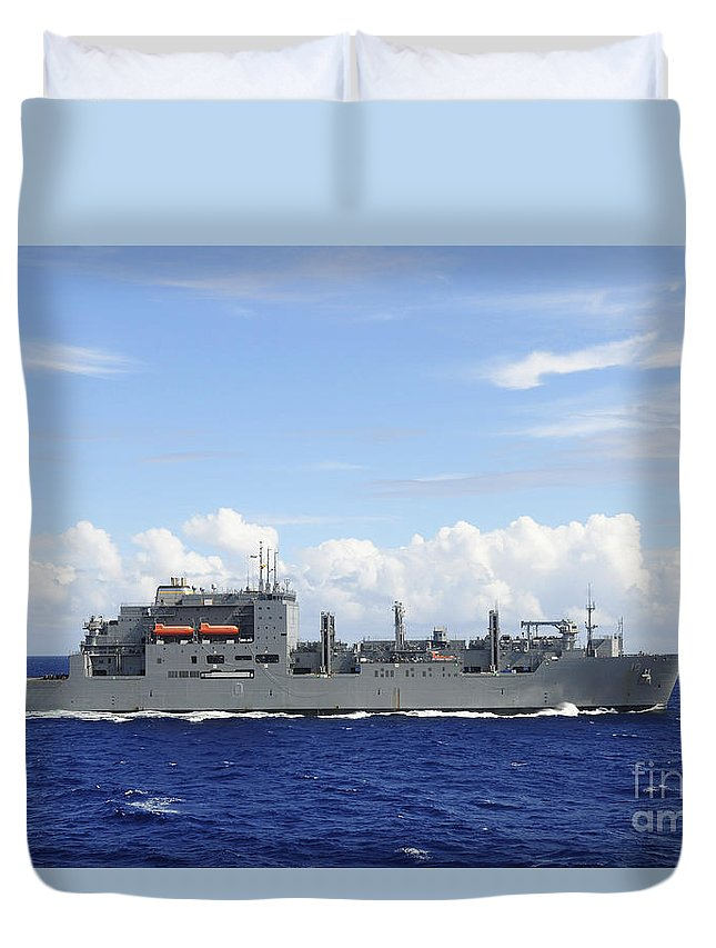 Usns Charles Drew Duvet Cover featuring the photograph An Mh-60s Sea Hawk Prepares To Drop by Stocktrek Images