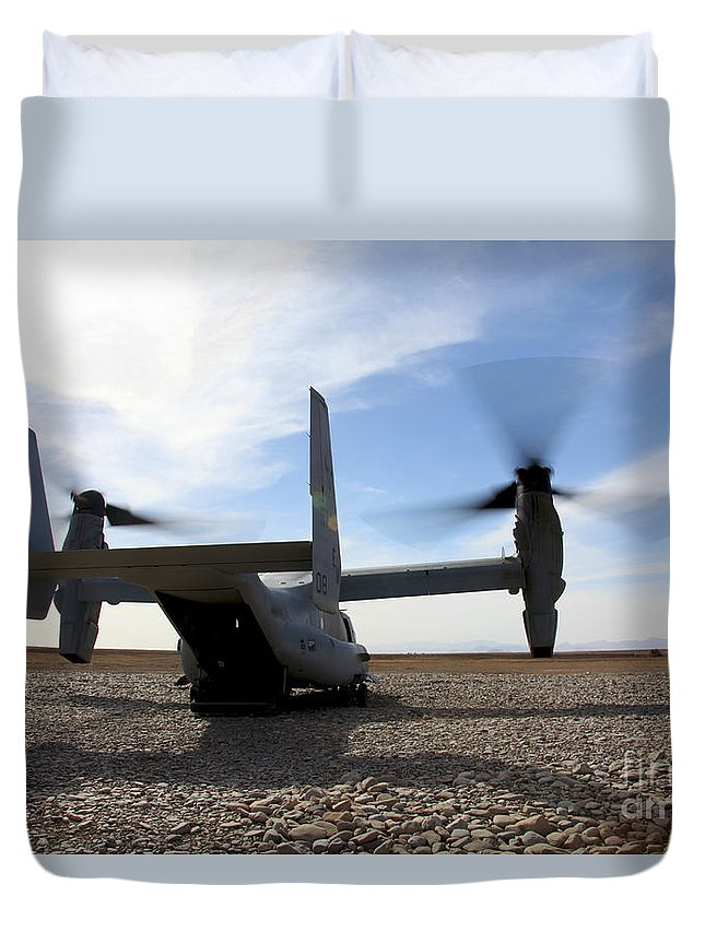 Mv-22 Duvet Cover featuring the photograph An Mv-22 Osprey Sits Outside A Forward by Stocktrek Images