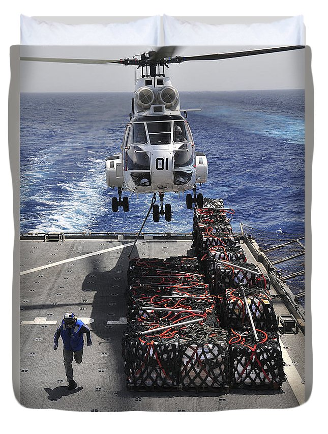 Military Sealift Command Duvet Cover featuring the photograph An Sa-330j Puma Helicopter Picking by Stocktrek Images