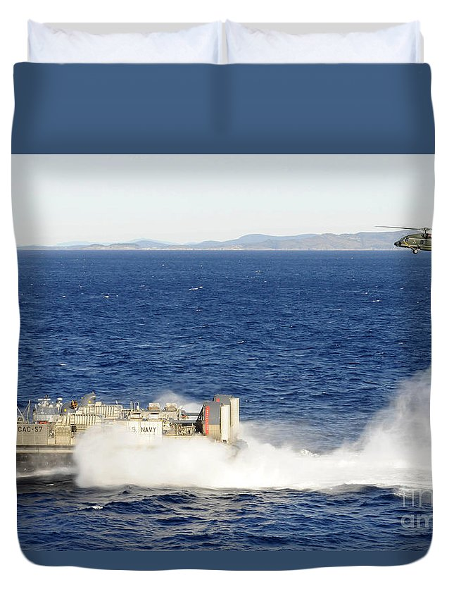 Coral Sea Duvet Cover featuring the photograph An Sh-60f Seahawk Helicopter Follows by Stocktrek Images