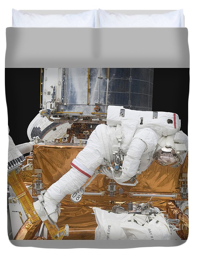 Gravity Duvet Cover featuring the photograph Astronaut Working On The Hubble Space by Stocktrek Images