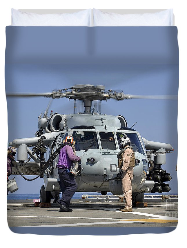 Maritime Duvet Cover featuring the photograph Aviation Boatswain's Mates Run by Stocktrek Images