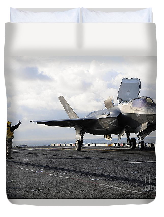 Maritime Duvet Cover featuring the photograph Aviation Boatswains Mate Signals by Stocktrek Images