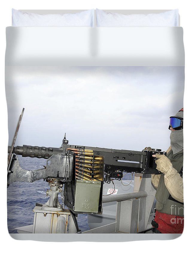 Protective Clothing Duvet Cover featuring the photograph Aviation Ordnanceman Fires by Stocktrek Images