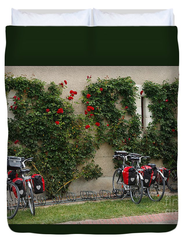 Bicycles Duvet Cover featuring the photograph Bicycles Parked By The Wall by Louise Heusinkveld