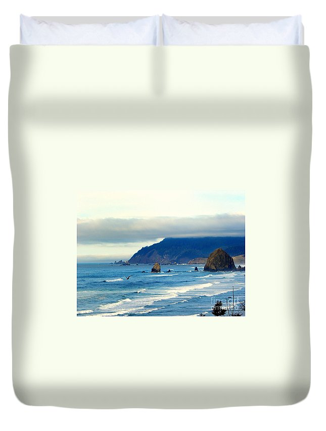 Bird Duvet Cover featuring the photograph Haystack Rock by Tisha Clinkenbeard