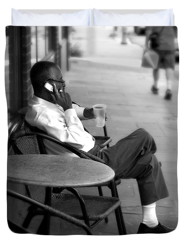 Street Photography Duvet Cover featuring the photograph Black Man Relaxing On Sidewalks Of Asheville by Gray Artus