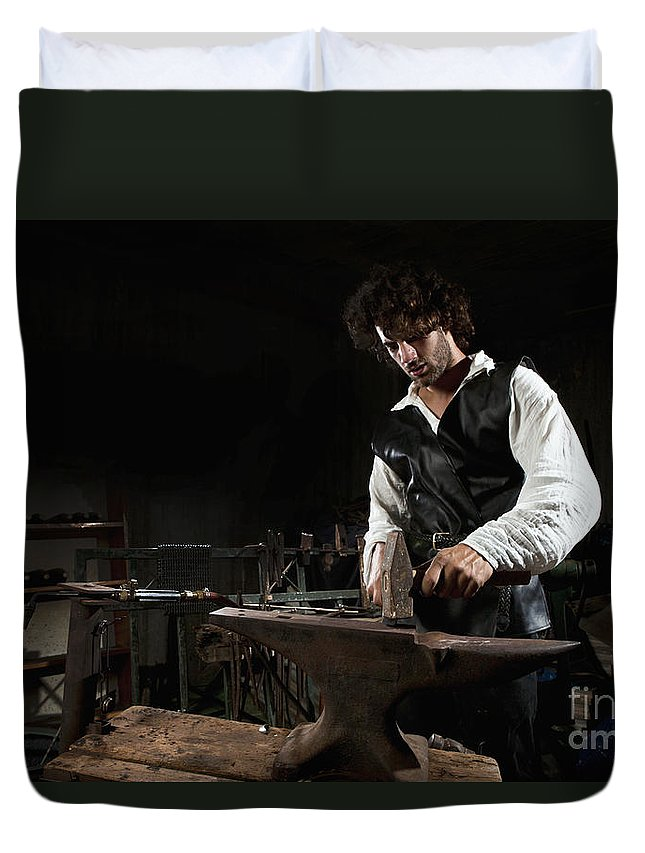 Blacksmiths Duvet Cover featuring the photograph Blacksmith by Yedidya yos mizrachi