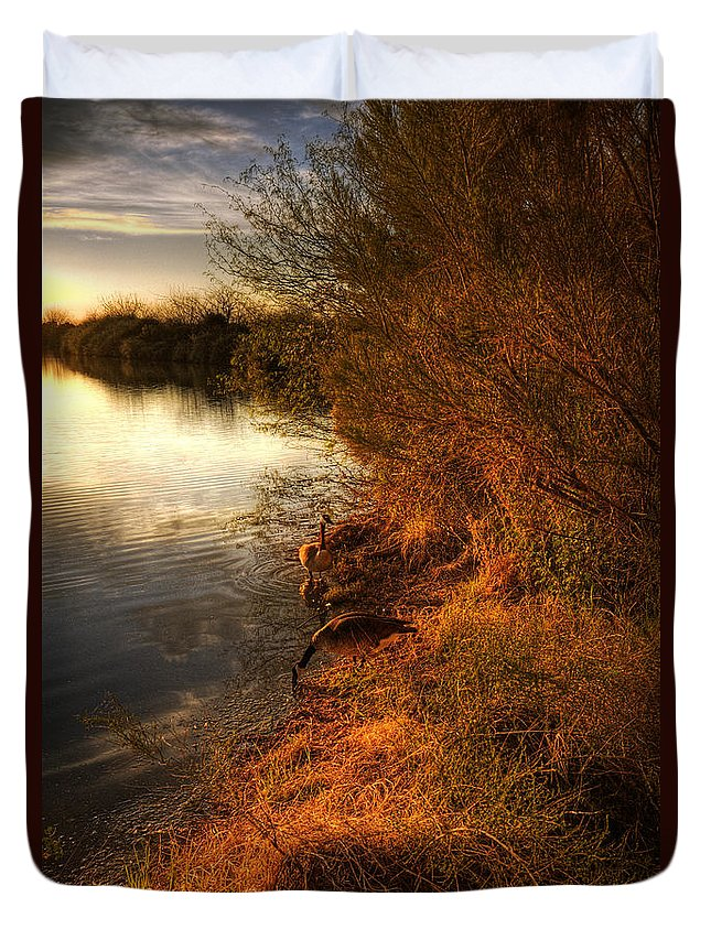 Sunset Duvet Cover featuring the photograph By The Evening's Golden Glow by Saija Lehtonen