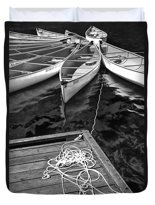 Art Duvet Cover featuring the photograph Canoes Docked At Lost Lake by Randall Nyhof